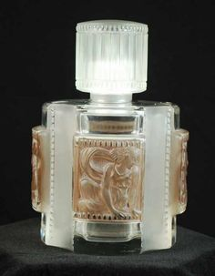 Rene Lalique St Helene? perfume bottle, c1942, clear and frosted glass with sepia patina, with stopper and lid, acid etched, stencil mark, R. Lalique, marcihac number 634. Height 13.5 cm