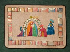 Folk Art Nativity Applique A delightful nativity scene for brightening up your Christmas. It would be perfect for a child's room or a throw for their bed, or as a wall hanging or lap robe for decorating. You can stitch jsut the center of the designs or include the border for a larger project. The designs are created to use with Embroidery Glitter but you can also use fabric for the applique sections.