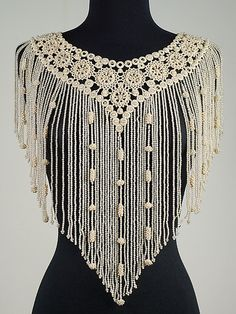 Collar from the Metropolitan Museum of Art--- French from 1892----  tatting and beads!