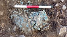 """Metal detectorist found guilty of Roman coin theft in Norfolk """"nighthawking"""" incident  -  A photo of an enormous number of green and grey coins"""