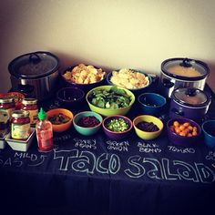 taco salad bar idea - chalkboard paint a 4\'x8\' sheet of plywood and create your own buffet serving table!