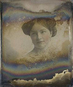Unidentified woman, circa 1852.  This image is a daguerreotype with applied color. I think the deterioration of the photo adds to its charm.  Just glad it didn't cover up her lovely face.