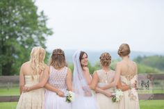 A cute pose with your bridesmaids - have all your bridesmaids stand arms around each other with the bride peeking over her shoulder!