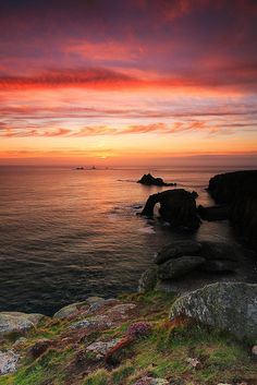 Lands End Sunset, Cornwall, England. Even the tacky 'amusements' can't ruin the beautiful natural scenery :)
