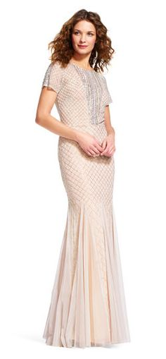 Sequins sparkle on this mermaid gown making it the perfectly accessorized  piece. This short sleeve 2f699850438b