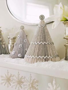 A mini forest of silvery trees made from paperback books adds a shimmering touch to the mantel. DIY instructions start on slide 6: http://www.familycircle.com/holiday/christmas/decorations/festive-holiday-crafts/#page=6