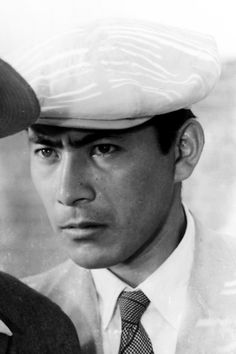 """Toshiro Mifune in """"Stray Dog"""" (1949)....Toshiro Mifune (1920-1997) was a Japanese actor who appeared in almost 170 feature films. He is best known for his work with filmmaker Akira Kurosawa in such works as """"Rashomon"""", """"Seven Samurai"""", """"Throne of Blood"""", and """"Yojimbo""""...."""