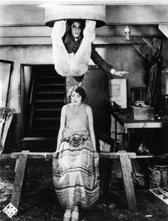Buster Keaton hangs over Kathryn McGuire's head in a scene from 'The Navigator' (1924)