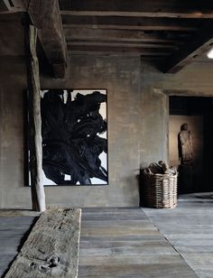 Interior design by Axel Vervoordt. Love this painting.