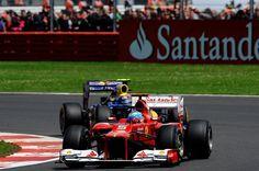 Fernando Alonso (ESP) Ferrari F2012 is chased by race winner Mark Webber (AUS) Red Bull Racing RB8.