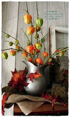Chinese Lantern in an old pewter pitcher as Fall home decor with a rustic feel.