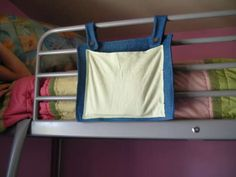 Kids need this: bunkbed organizer for books/ds/etc
