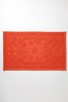 Pretty Orange - not sure if it would match my bathroom (or fit), but I loooove it.  Woven Portuguese Bathmat #anthropologie