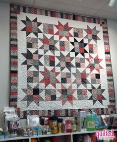 Just a picture, but I love it! Center part could easily be done with layer cake with four patches for the corners in the border too, would use every square.