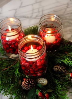 Add cranberries to these Mason jars for a gorgeous centerpiece.