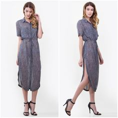 """NWT Striped Belted Shirtdress NWT - Sleek navy stripes line a light-weight midi-length shirtdress styled with a bias-cut, collar-to-hem button placket and a flouncy, figure-defining belt at the waistline. Thigh-high slits on both sides give the design a flirty kick. Available limited quantity in sizes: XS, S, M, L - Leave a comment with requested size & I will make a size specific listing for you to purchase.   48"""" length (size Medium). Front button placket. Chest patch pocket. 100%…"""