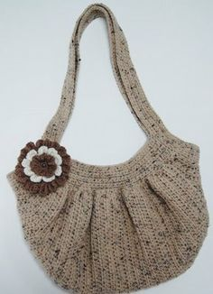Crochet purse tutorial, including liner. The design looks like it would bear weight well.