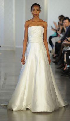Strapless satin gown with beading embellishments on the bodice | Oscar de la Renta Spring 2017 | https://www.theknot.com/content/oscar-de-la-renta-wedding-dresses-bridal-fashion-week-spring-2017