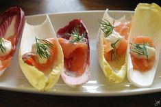 """... smoked salmon into 1"""" pieces & put one on each endive leaf. Add"""