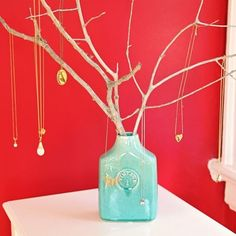 DIY Jewelry Tree. Best one I've seen - I'm not about to go drilling holes in the bottom of twigs and using screws to attach it to a wooden block!
