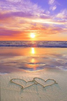 Perfect romantic beach sunset with hearts drawn in the sand. Perfect romantic beach sunset with hearts drawn in the sand.