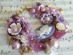 Fairies in the Garden... pink and plum flower fairy bracelet with new and vintage flowers