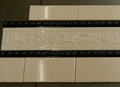 Subway tile black rope tile and vine accent tile. Perfect