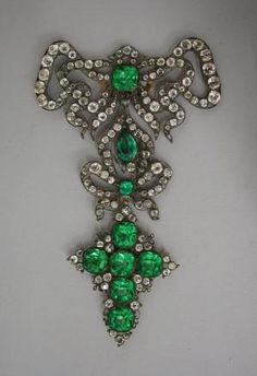 Bodice ornament (ornement de corsage) France, 18thC, pierced silver frame, clear glass, green and pink briolette. Les Arts Decoratifs