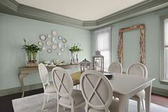 Wyethe Blue from Benjamin Moore - a gorgeous blue green color perfect for a dining room. I love the plate wall!