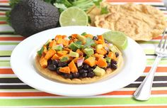 Black Bean and Sweet Potato tostadas... I HAVE to try these! Black beans and sweet potato are some of my favorite ingredients.