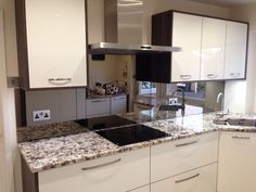 Bronze Toughened Mirror manufactured and installed by CreoGlass Design (London, UK). View more kitchen splashbacks and non-scratch glass worktops on http://www.creoglass.co.uk/kitchen-glass-splashbacks/toughened-mirrors/