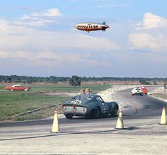 Ferrari 250 GTO at Sebring 1963 The Rosebud Racing Team Ferrari 250 GTO of Richie Ginther and Innes Ireland heading out to the airport straights at Sebring in 1963. Overhead the Good Year blimp watches the action and in some races reported the action on commercial radio. The car was powered by a three-liter V12 and would finish 6th and 13 laps behind the winning factory Ferrari 250 prototype of John Surtees and Ludovico Scarfiotti.