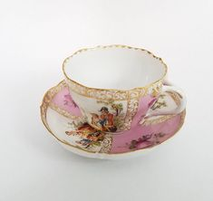 Stunning antique porcelain tea cup and saucer set by Louis Levinsohn, dated between 1886-1891. This beautifully hand-painted set pictures a man a woman in various poses together along with flowers and heavy gold detail. Ive pointed out a chip in the saucer, no other damage. There