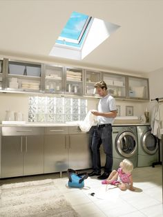 Vivacious Velux Skylights for Your Roof Window Ideas: Attractive Single Venting And Sunlight Temp Glass Velux Skylights Over Laundry Ceiling Decor With Modern Front Loader Chrome Washing Machine In Contemporary Laundry Room Decor Ideas Modern Laundry Rooms, Laundry Room Layouts, Laundry Room Storage, Laundry Room Design, Laundry Area, Small Laundry, Skylight Window, Roof Window, Utility Room Designs