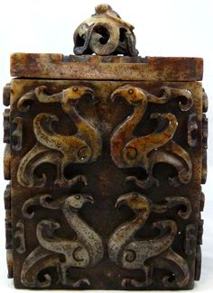 "ANTIQUE CHINESE RED JADE PHOENIX COVERED BOX Beautifully crafted hand carved red jade box. Has raised Phoenix design to exterior. Cover has a figural dragon and lotus blossom design. 19th century. Signature to bottom. Measures 7 1/2"" height x 5 1/8"" length x width (19cm x 13cm x 13cm"