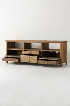 from anthropolgie.com. I think I could modify our existing TV stand to resemble this....
