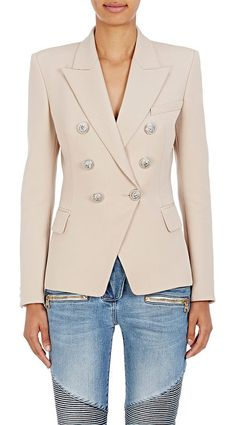 Wool double-breasted blazer-brown by Balmain. Balmain's beige plain-weave wool double-breasted blazer is detailed with the house's signature buttons. Silvertone si...