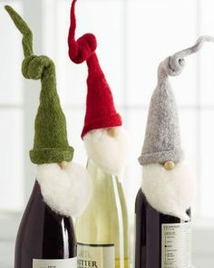 Furry beards and bendable woolly felt hats make this trio of charming Santas essential guests for holiday parties and special dinners.