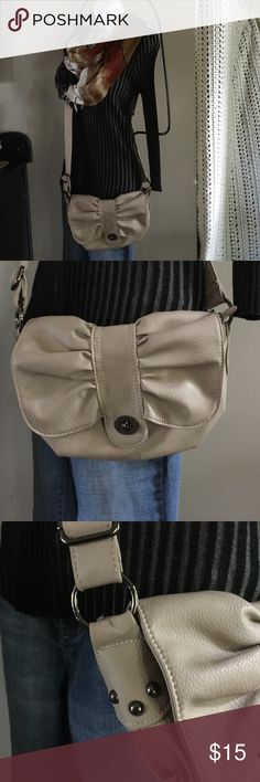 Light tan/taupe crossbody purse Ruching/pleated 💕 Pretty! Only carried once! Excellent new like condition! 💕A neat design pleated/ruching flap closure(turn key like)  -long adjustable crossbody strap this is a light tan or taupe in color, made by Under one sky, faux leather like material & just NEAT! This is a smaller to medium purse w/ 1 zippered pocket inside, 2 smaller slit like pockets & a roomy main area. Super stylish & neutral color! ❤️the design!💕👛 Adjustable strap drop approx…