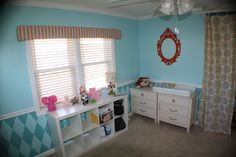 The red ornate mirror adds an elegant touch to this aqua nursery  #red #aqua #nursery