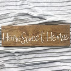 """There truly is no place like home! If you're like me, home is your most favorite place to be. This classic """"home sweet home"""" saying is the perfect addition to your living room gallery wall or kitchen! Wood signs are a perfect addition to any farmhouse decor!"""