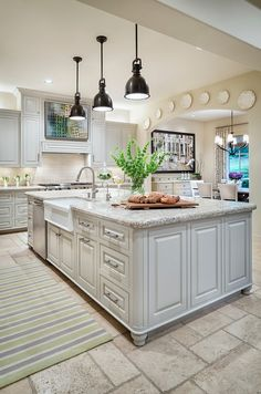 Designed by Martha O'Hara Interiors and photographed by Piston Design-Paul Finkel Photography. The cabinet paint color is Benjamin Moore Shale 861. Ceiling Paint Color: Benjamin Moore Lambskin 1051. Wall Paint Color: Benjamin Moore Sea Urchin 1052.