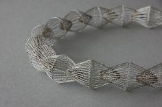 Ines Schwotzer--Necklace in steel wire bobbin lace