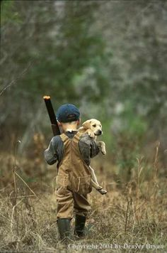 this is so cute. i love everything about it. the adorable puppy and the little boy and the gun
