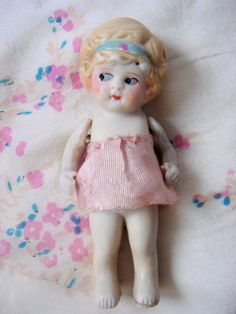 1920's Bisque Flapper Doll by iloveluci on Etsy, $65.00  I think I paid $3 for mine! But she needs a dress...dress idea here
