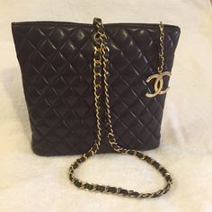 "Chanel quilted bag, Lamb skin crossbody black Authentic CHANEL CC logo The bag comes with chanel carebook. There is a horogram/ date code reads: 1325676 Size: L 11.5"" x H 10"" x W 2.75"" Condition: This bag is used and has sign of wear, and some discolored on hardware, but still in good condition, No tears, rips, stain, or major damage.        Over all the bag is in good condition. Please see the pictures for more detail and detail.    PLEASE NOTE THAT THE DUST BAG SOLD, IT DOES NOT COME WITH…"