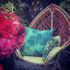 """A corner of the courtyard in the peaceful garden at the Hendrick's Horticultural Oasis at Blakes Hotel. Matthew Williamson contrasted fabrics from his collection with Osborne & Little with objets d'arts from Rockett St George and antique shops and markets. The peacock chair was bought by Matthew in a market and is his favourite piece. """"It's a real eye-catcher and sums up me and my style rather well. It's found a perfect new home for the summer in the Blakes courtyard garden."""""""