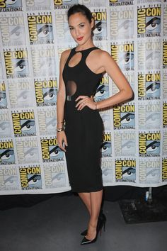 Pin for Later: You Only Need 13 Reasons to Start Obsessing Over Gal Gadot's Style  Body-con babe! Gal showed up to Entertainment Weekly's Women Who Kick Ass panel during Comic-Con in a tight cutout black dress by David Koma.