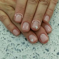 Nude nails with a white heart. Valentine's day nails. :D