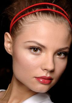 soft makeup, berry stained lip , red accessory